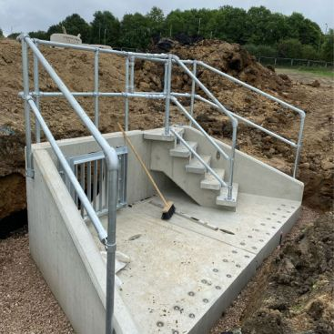 SFA headwall with PCC steps being installed